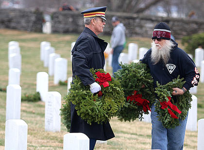 Veterans volunteer their time to place wreaths at Lebanon National Cemetery.
