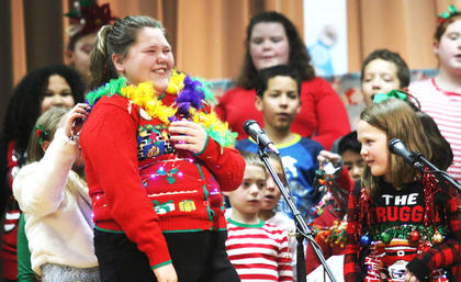 Bryllie Lane and MaKenzie Greene, Calvary Elementary School, get decorated like Christmas Trees during the Karaoke Christmas show.