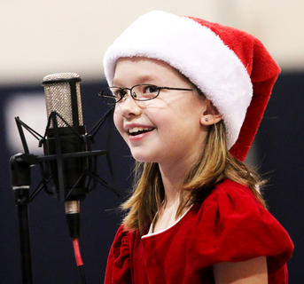 Lakota Thompson, West Marion Elementary, as Mrs. Claus dazzles the audience with her voice and smile.