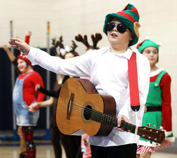 Tristen Hamilton, West Marion Elementary, is Elfus, a famous Elf singer, rocking out with his North Pole friends and band.