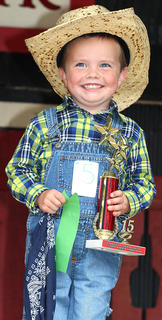 Bryce Cecil beams with pride as he is named this year's Junior Farmer at Marion County Country Ham Days. He's the son of Amanda and Jeffery Cecil.