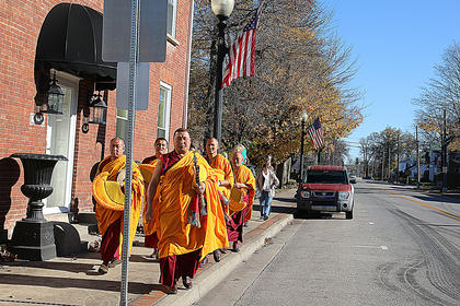 Seven monks from the Labrang Tashi Kyil Monastery in Dehra Dun, India made Marion County their home for a week during November. The monks will return to the area when they visit St. Catharine College Jan. 25-29. Pictured are the monks as they walk through downtown Lebanon.