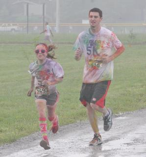 A pair of runners near the finish line of the Color in Motion 5K held Saturday morning.