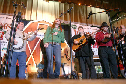 "Maci Belfiore sings accompanied by Gary ""Biscuit"" Davis, left, and Billy Hill (guitar), Joe Dant (mandolin) and Ray Mattingly (fiddle) of the Honeysuckle String Band during a jam session Friday night at Marion County High School during the 2012 Kentucky Bluegrass Music Kickoff."