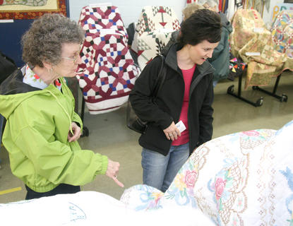 Wanda Dye, left, and Ann Mattingly visit the Kentucky Bluegrass Quilt Show Saturday at Marion County High School. Mattingly also created the second-place entry in the show.