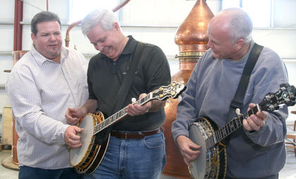 "Gary ""Biscuit"" Davis visited the Limestone Branch Distillery, where he showed owners Paul (center) and Steve Beam how to play the banjo."