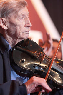 Lambert Lyvers, 85, played the fiddle for a few songs Friday evening.