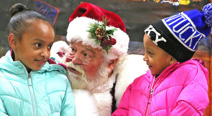 Sisters Adriana Brown, 9, left, and Zariyah Brown, 6, both of Lebanon tell Santa Claus what they want for Christmas.