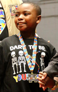 Jaron Xavier Newby, 8, of Bardstown shows off his handsome smile after receiving his medallion. He's the son of Demitra and Charles Newby.