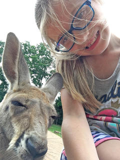 Ally Cecil gets takes a selfie with a kangaroo at Kentucky Down Under. She is the daughter of Todd and Kelly Cecil.
