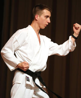 Ben Buckman performs a martial arts routine during the talent portion of the competition.