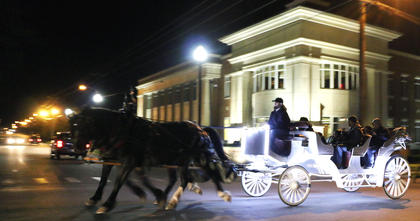 Dickens Christmas festivities included carriage rides along Spalding Avenue.