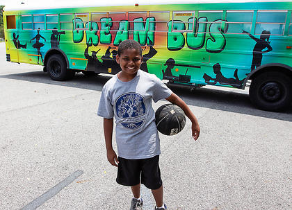David Smalley dribbles his way to the Dream Bus.