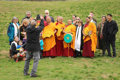 Say cheese! The monks and their new friends stopped for a group photo after the closing sand pouring ceremony.