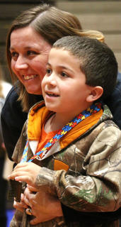 Luke Sauter, 8, of Bloomfield poses for a photo with his mother, Leslie, after receiving his medallion.