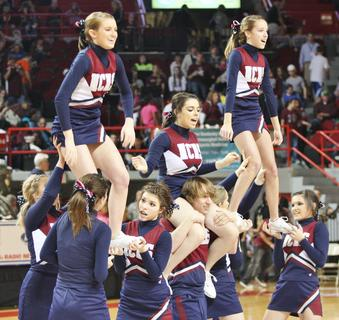 The Marion County High School cheerleaders performed a routine at halftime of the first round game against Walton-Verona.