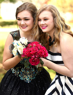 Sisters Libby and Jane Palagi pose for a photo prior to prom. This photo was taken by Bob Abell.