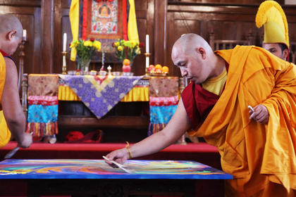 Yeshi Rabgya prepares the sand mandala to be dismantled.