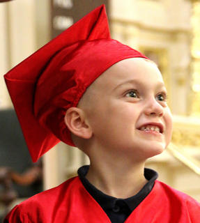Miles Hoeck shows off his pearly whites during St. Augustine's preschool graduation ceremony Friday afternoon.