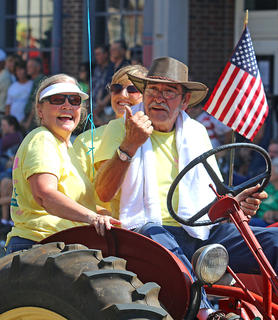 The Mudd family has some fun in the Pigasus Parade Saturday. Pictured are Mike Mudd, his wife Sandy, and their daughter-in-law Kim.