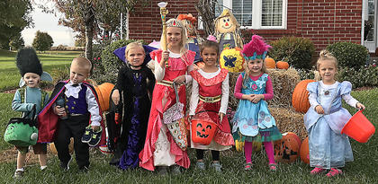 """Pictured, from left, are Connor Sizemore (dressed as Branch from the movie """"Trolls""""), Matthew Sapp (dressed as a vampire), Madeline Sapp (dressed as a vampire), Reagan Edlin (dressed as princess Elena), Reese Rogers (also dressed as princess Elena), Madison Sizemore (dressed as Poppy from the movie """"Trolls"""") and Elle Rogers (dressed as Cinderella)."""