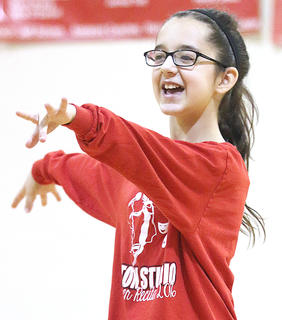 Amira Bowman performs a dance routine during St. Augustine Grade School's talent show recently.