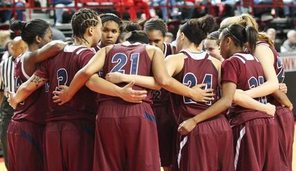 The Marion County Lady Knights huddle up right after halftime in the state tournament game against Bowling Green.