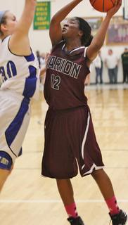 Patrice Tonge prepares for contact as she goes up for a shot during Marion County's regional championship win.