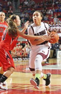 Senior Makayla Epps takes the ball to the basket and gets fouled in the semifinal win over Anderson County.