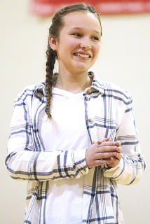 Leah Wright smiles as she performs with her classmates.