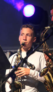 Jacob Hinton, 12, plays saxaphone with the horn section of the Marion County All Star Band.