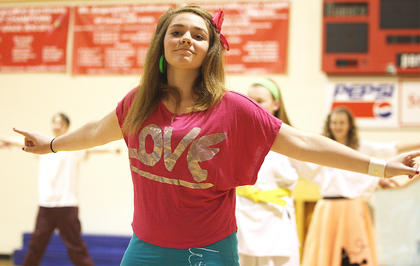 Jaci Benningfield performs a dance routine with her classmates.