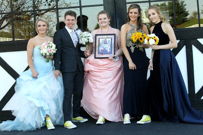 Pictured, from left, are Cassidy Logsdon, Matthew Pelfrey, Tori Thompson, Hope Rawlings and Brooke Davis. They all wore yellow converse shoes in memory of fellow classmate Olivia Ford who died in a car accident in February.