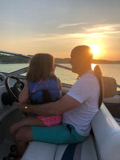 Millie Hardesty and her dad, Jason, enjoy a sunset at Green River Lake.
