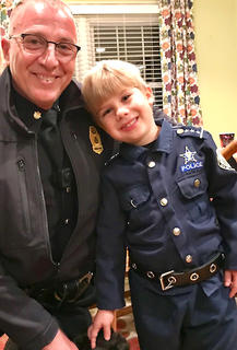 Pictured is Lebanon Police Major Greg Young with Alex Mullins.