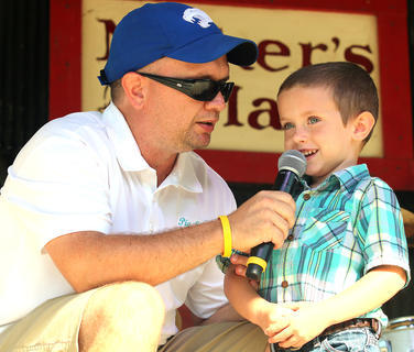 Lucas Green, 4, talks with emcee Jeremy Bowman during the Tommy Burress Junior Farmer contest. Green won the Junior Farmer competition. Green is the son of Ashley and Anthony Green.