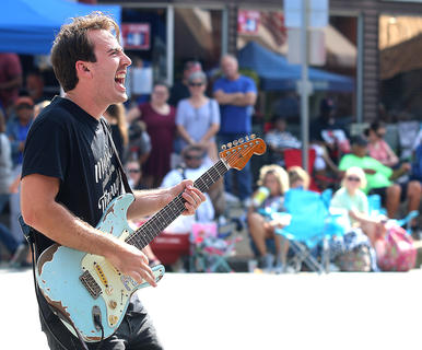Singer, songwriter and musician Paul Childers and his band The Black Tie Affair performed at Ham Days after the Pigasus Parade Saturday afternoon. Childers was also the grand marshall of the Pigasus Parade.