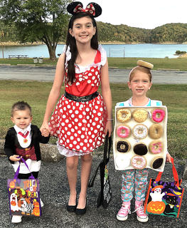 Pictured, from left, are Silas Lee dressed as a vampire, Claire Lee dressed as Minnie Mouse, and Torri Probus dressed as a box of donuts. They attended the Green River Lake Trick or Treat.
