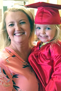 "Madelyn Shannon is pictured with her ""Mimi"" Kathy Shannon after graduation at St. Augustine Grade School."