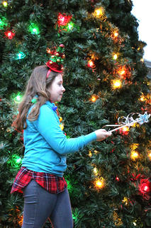 Macy Sharp helps kick off the Dickens Christmas festivities on Friday evening by lighting the community Christmas tree. She is the daughter of Victoria Sharp.