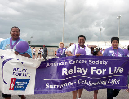 From left, Annette Bell, Nikki Thornton, Sydney Briggs and Ollie Calhoun carried the banner during the survivors lap.