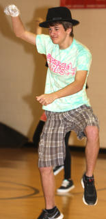 Aaron Howard gets funky while performing a dance routine with his classmates.