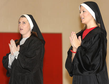 """From left, teachers Renee Spalding and Lenae Thompson perform a routine from """"Sister Act."""""""
