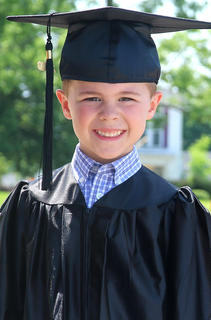 Hagan Evans is only four years old, but he looks so studious and scholarly in his cap and gown.