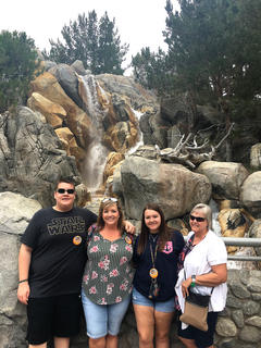 Briley, Trevor and Kim Mudd and Janice Thompson pose for a photo during their vacation at Disneyland in California in June.
