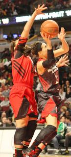 Makayla Epps blocks a shot from a West team player during the McDonald's All American Game last Wednesday night at the United Center in Chicago.  Epps had 13 points in the East team's 92-64 loss to the West team.
