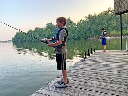 Owen and Isaac Wright enjoy some fishing from the dock at Lake Barkley.