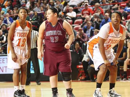 Senior Ashley Bridgewater prepares to grab the rebound on a Hopkinsville free throw attempt.