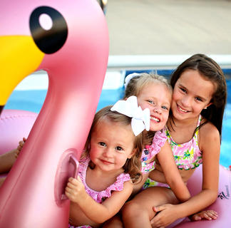 Pictured are Caroline, Madeline and Alani Wheatley, daughters of Amy and Matthew Wheatley, at their grandparents pool.