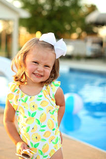 Caroline Wheatley strikes a pose at her grandparents pool. She's the daughter of Amy and Matthew Wheatley.